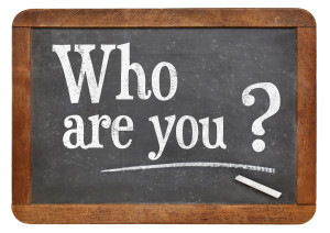 Who are you question  on a vintage blackboard isolated on white