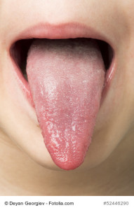 Human tongue protruding out. Child tongue.