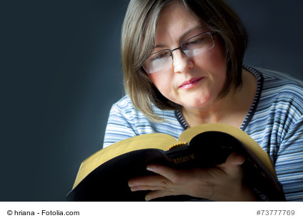 Adult Woman Reading a Bible. Close