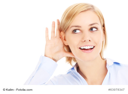 Young businesswoman listening somethink over white background