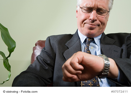 Man looking anxiously at watch