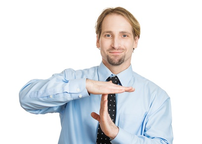 Closeup portrait young, happy, smiling, man showing a time out gesture with hands, isolated white background. Positive emotion facial expression feelings, body language